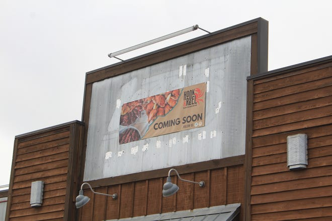 """A """"coming soon"""" sign for Hook & Reel restaurant is seen on the outside of the old Logan's Roadhouse, 6201 Rogers Ave., in Fort Smith on Thursday, March 11, 2021."""
