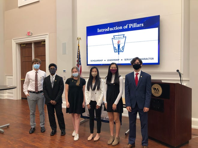 The officers for the New Albany High School chapter of the National Honor Society are (from left) Kaan Odabas, secretary of tutoring; Tawfiq Mohammed, treasurer; Olivia Herman, vice president; Nora Bounemany, secretary of hours; Danna Long, historian; and Max Little, president.