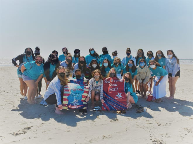 The Waxahachie High School Cherokee Charmers enjoy some time at Galveston Island beach during a break from last Saturday's dance competition.