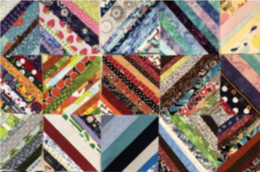 The city of Cambridge is displaying a commemorative quilt at the Main Cambridge Library made from over 50,000 masks stitched together by local stitch lounge, Gather Here, and Boston Area Mask Initiative (BAMI).