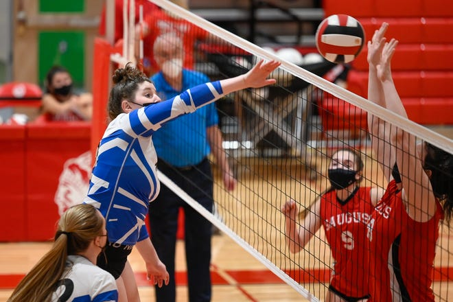 Meagan Murphy of Danvers spikes the ball during a volleyball match versus Saugus at Saugus High School on Thursday, March 11.