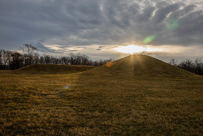 The sun rises over the mounds Friday morning located at the Hopewell Culture National Historical Park in Chillicothe, Ohio, on March 12, 2021.