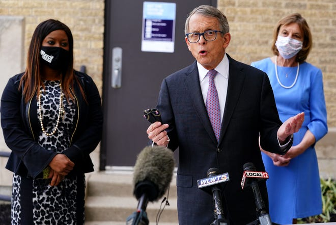 Ohio Gov. Mike DeWine addresses the media Friday after touring the Riverview Senior Apartments as residents receive vaccinations against COVID-19 in the East Walnut Hills neighborhood of Cincinnati.
