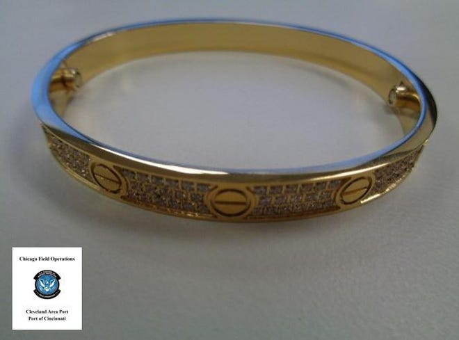 U.S. Customs and Border Protection officers in Cincinnati recently seized shipments from China containing fake Apple earbuds and counterfeit Cartier and Hermes jewelry like the fake Cartier bracelet seen here.