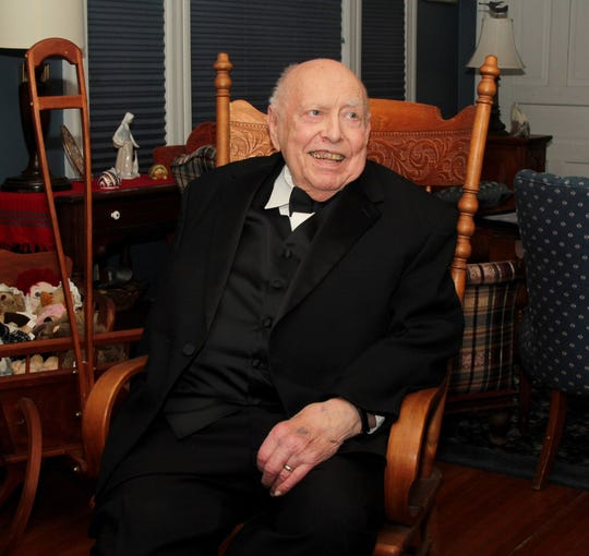 Quad-City historian Roald Tweet, then 83, sports a tuxedo for the first time on Saturday, Feb. 25, 2017, to attend the Junior Board of Rock Island's 78th Mardi Gras Charity Ball, where his grandson, Jackson, served as a page.
