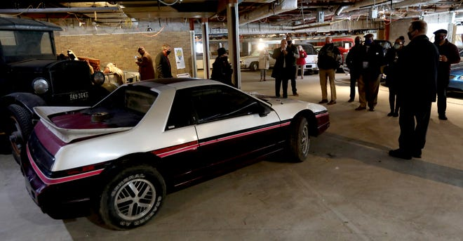 During a tour of the yet-to-open Pontiac Transportation Museum in Pontiac on March 4, 2021 philanthropist Tim Dye talks about the history of Pontiac cars including this Pontiac Fiero at the museum located in the former Crofoot Elementary School. Dye and others hope to open in the fall of 2021 and are seeking funds to turn the school into an event space and museum that will display a variety of vehicles made in the city of Pontiac.