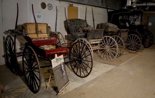 Old Pontiac buggies displayed in a row at the yet-to-open Pontiac Transportation Museum in Pontiac on March 4, 2021.