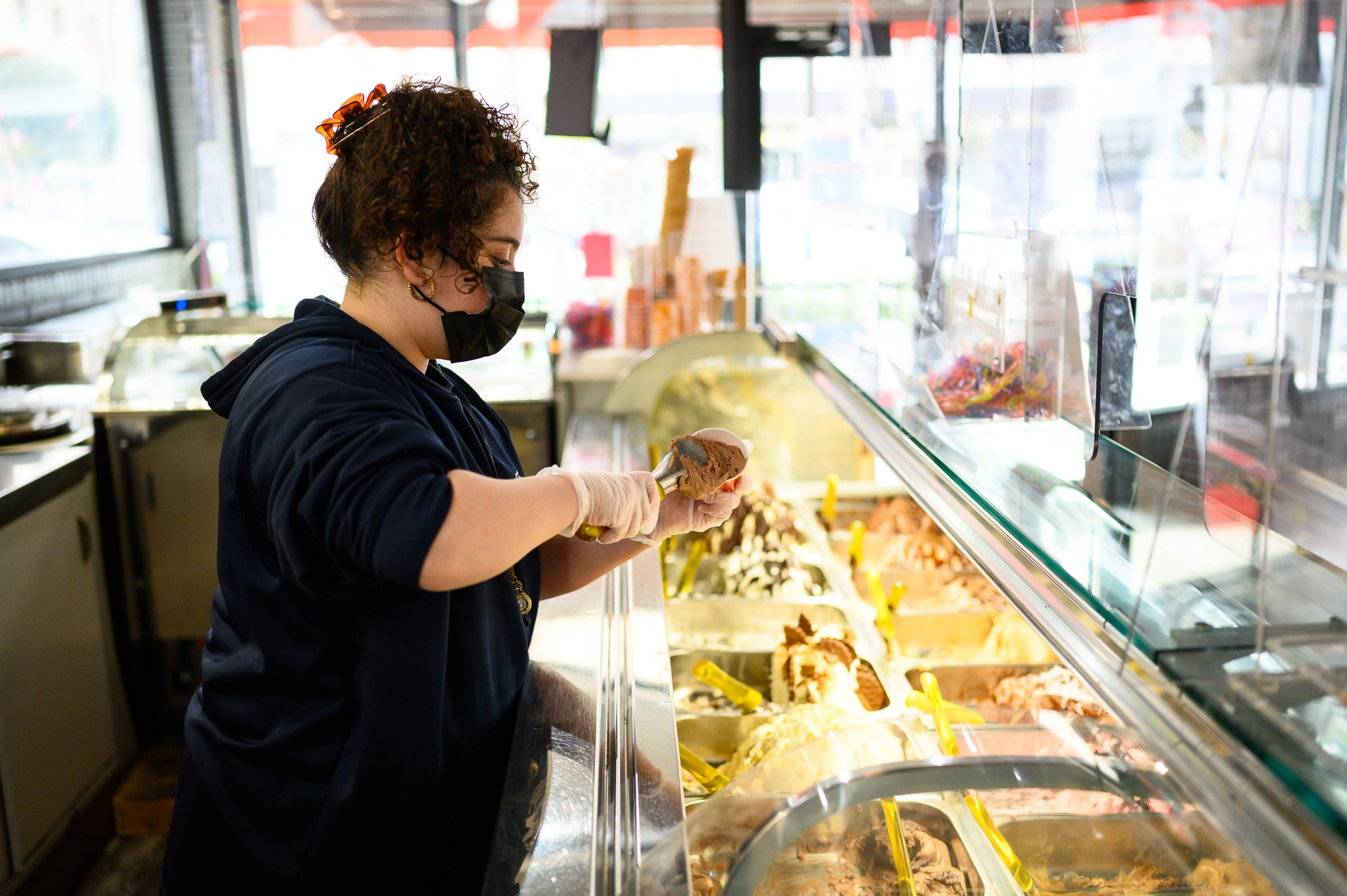 Mia Ortiz scoops a cup of gelato for her brother Luca at Luna Rosa Gelato Cafe downtown Thursday, March 11, 2021.