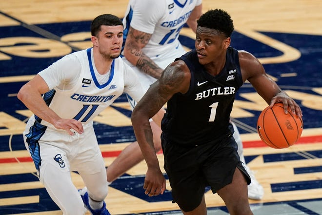 Butler's Bo Hodges (1) spins away from Creighton's Marcus Zegarowski (11) during the first half of an NCAA college basketball game in the Big East conference tournament Thursday, March 11, 2021, in New York.