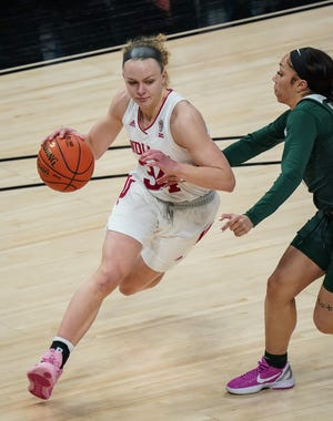 Indiana Hoosiers guard Grace Berger (34) rushes towards the net during the Big Ten tournament, Thursday, March 11, 2021 at Bankers Life Fieldhouse in downtown Indianapolis.