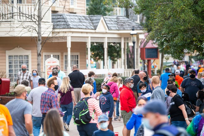 """Season pass holders walk through Showstreet during """"Season Passholder and Media Preview Day"""" at Dollywood on Friday, March 12, 2021. Dollywood has recently changed its mask policy, but it's still adhering to CDC guidelines."""