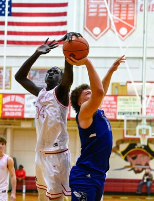 Bol Kuir, a 7-foot-3 junior playing his first season of high school basketball, is averaging 14.8 points, 14.2 rebounds and 4.0 blocks for Belfry High in eastern Kentucky.