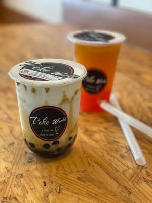 A Milk Bubble Tea and a Passion Fruit Bubble Tea at Poke World on Erin Drive in East Memphis.