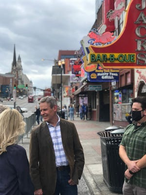 Gov. Bill Lee chats maskless outside on Lower Broadway in Nashville. The city still has a mask mandate in effect.