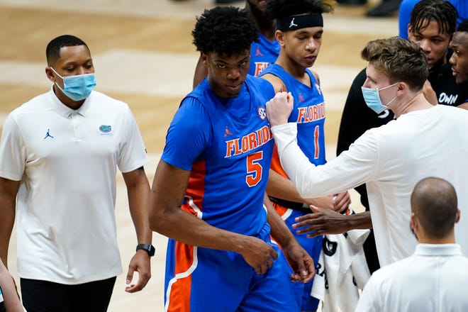Florida forward Omar Payne (5) exits the court after being ejected during the second half of the SEC Men's Basketball Tournament game against Tennessee at Bridgestone Arena in Nashville, Tenn., Friday, March 12, 2021.