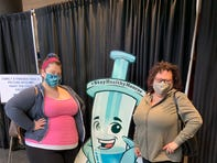 "Erin Francis, L, and her mother Toni Weasner posing with ""Vinnie Vaccine"""