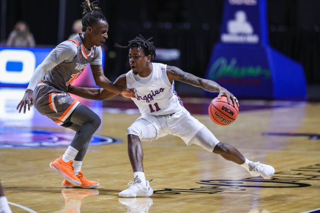 Kalen Williams (11) works past a defender as the New Mexico State Aggies face the University of Texas Rio Grande Valley Vaqueros at The Orleans Arena in the quarterfinals of the WAC Tournament in Las Vegas on Thursday, March 11, 2021.