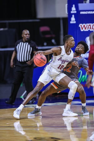 Jabari Rice (10) works past a defender as the New Mexico State Aggies face the University of Texas Rio Grande Valley Vaqueros at The Orleans Arena in the quarterfinals of the WAC Tournament in Las Vegas on Thursday, March 11, 2021.