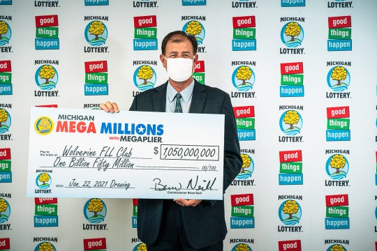 Kurt D. Panouses mewakili empat anggota Wolverine FLL Club, yang memenangkan lotere $ 1 miliar Mega Jutaan pada bulan Januari.