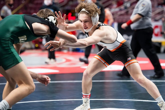 Harbor Creek's Connor Pierce, right, wrestles Lewisburg's Kaiden Wagner in a 132-pound quarterfinal bout at the PIAA Class 2A wrestling championship at the Giant Center in Hershey on Friday. Pierce won by decision, 6-0.