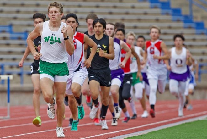 Wall High School's Tate Hughes leads the pack in the Division II boys 800 meters at the San Angelo Relays on Thursday, March 11, 2021.