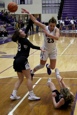 Winner junior Bella Swedland fires a pass to the corner after drawing contact from Dakota Valley's Rylee Rosenquist and Peyton Tritz during the first half of Thursday's first-round Class A State Tournament game.