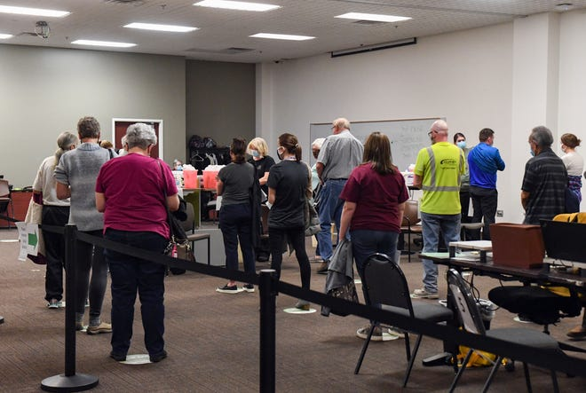 Teachers join the lines of citizens eligible for the COVID-19 vaccine on Thursday, March 11, 2021, at the Avera Health vaccine clinic in Sioux Falls.