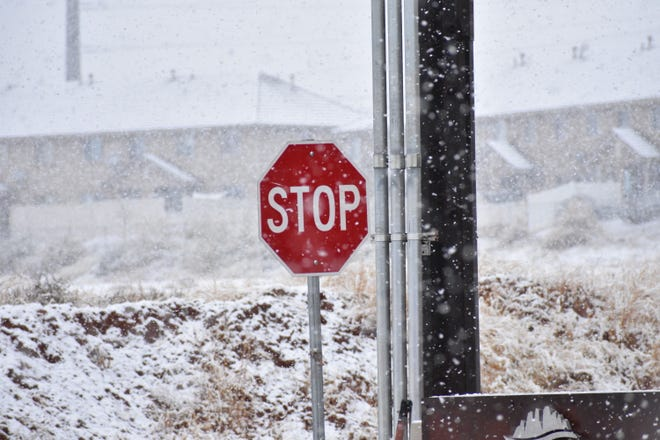 The snow fall, like here in Washington City, is expected to continue through Saturday.