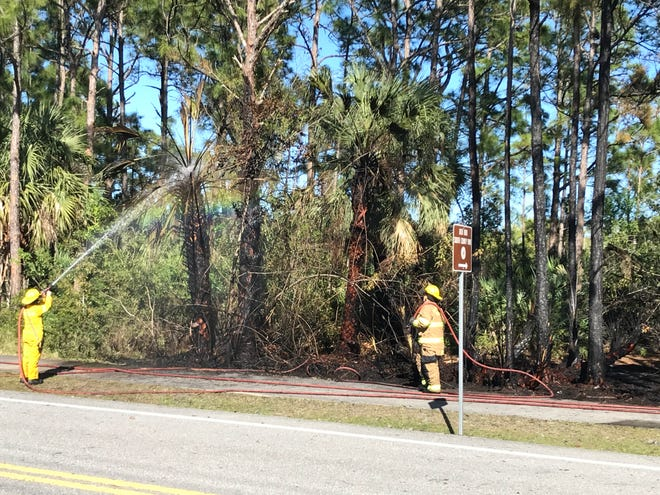 Indian River County Fire Rescue firefighters put out a roadside blaze that shut down 20th Avenue Southwest by South County Park off Oslo Road from roughly 3 p.m. to 4 p.m. Friday, March 12, 2021.