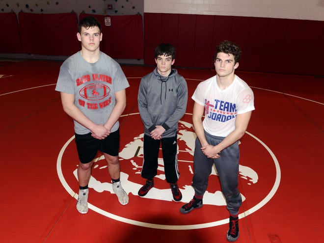 Sheridan's Logan Morris, left, Alexander Crane and Jordan Barnett are headed to the Division II state wrestling tournament this weekend at Sparta Highland High School. They are among a contingent of 11 Muskingum Valley League competitors at the event.