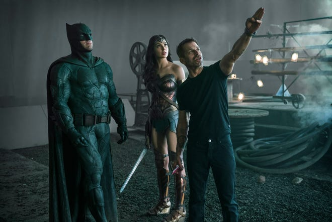 """Zack Snyder (far right) directs Ben Affleck and Gal Gadot on the set of """"Justice League."""""""