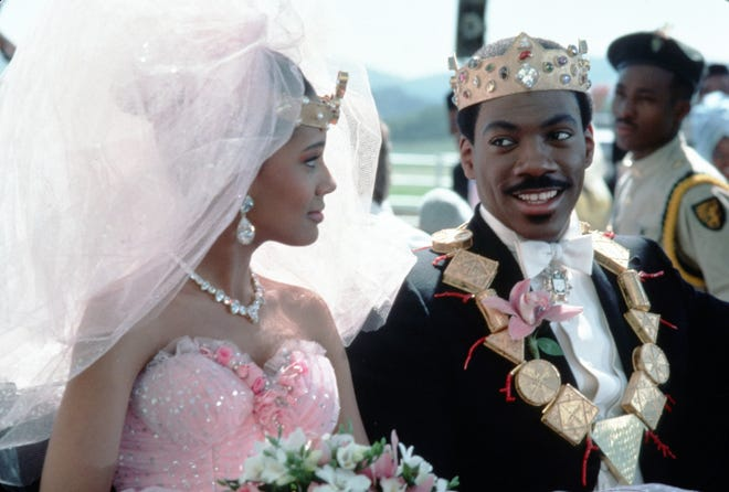 """Shari Headley's Lisa McDowell wore a scene-stopping wedding dress in 1988's """"Coming To America"""" to her nuptials to Eddie Murphy's Prince Akeem. The dress has been long admired and often copied."""