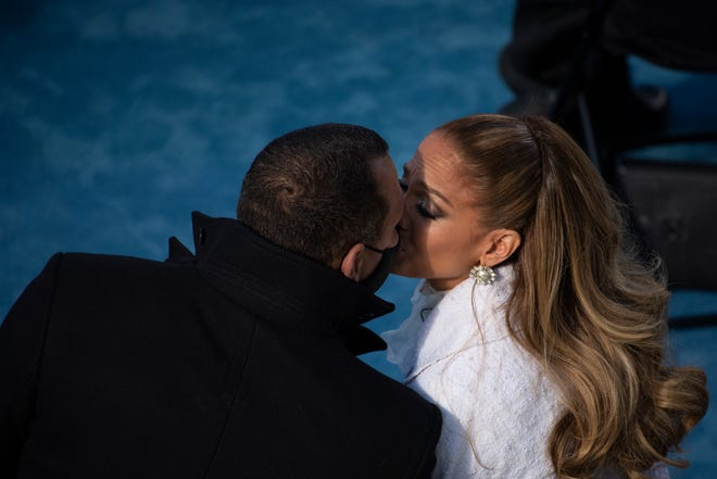 Jennifer Lopez kisses then-fiancé Alex Rodriguez after performing during the inauguration of U.S. President-elect Joe Biden on January 20, 2021 in Washington, DC.