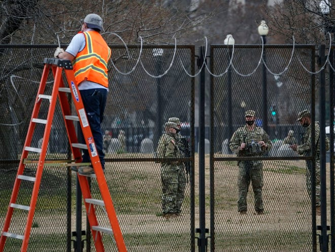 A fence refitted with security wire near the U.S. Capitol on Friday.
