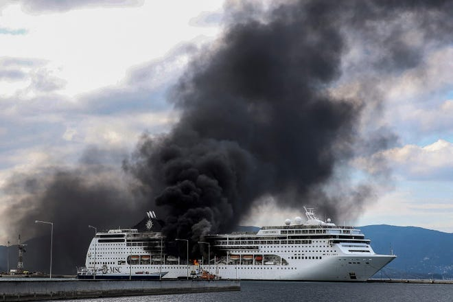 Cruiser MSC Lirica is pictured on fire, while docked in the port of the Greek island of Corfu on March 12, 2021. The fire is under control and no injuries were reported.