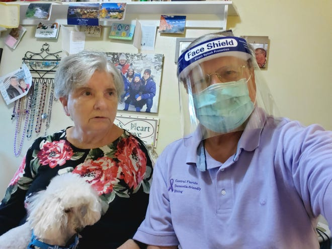 Dennis Dulniak visits with his wife, Nancy, on Sept. 22, 2020, at her assisted living facility in Florida under provisions allowing for compassionate care visits during COVID-19 at long-term care communities under shutdown orders.