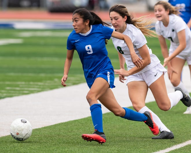 Pflugerville's Isela Ramirez, heading upfield against Cedar Park earlier in the season, scored two goals in the Panthers' 4-4 draw with Weiss Thursday. Pflugerville clinched the District 18-5A championship.