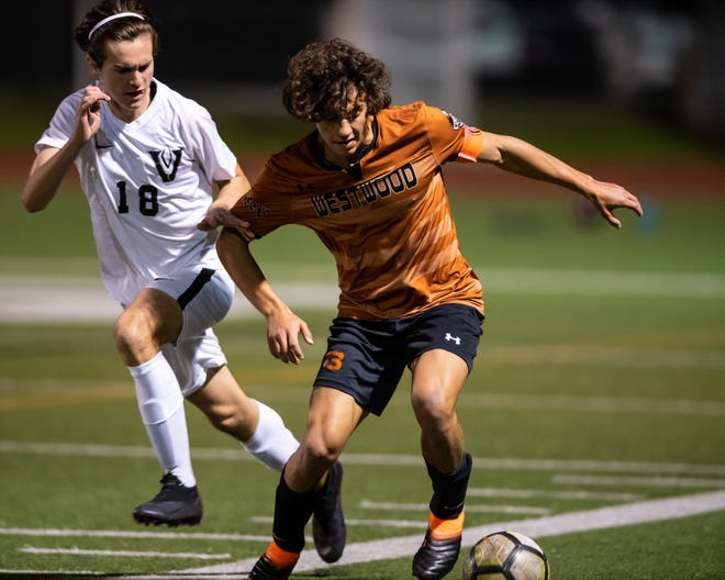 Westwood's Luca Cipleu, controlling the ball during a match versus Vandegrift earlier in the season, scored the game-tying goal in the Warriors' draw versus Stony Point Friday at Westwood High School. With the draw, Westwood clinched the District 25-6A title.