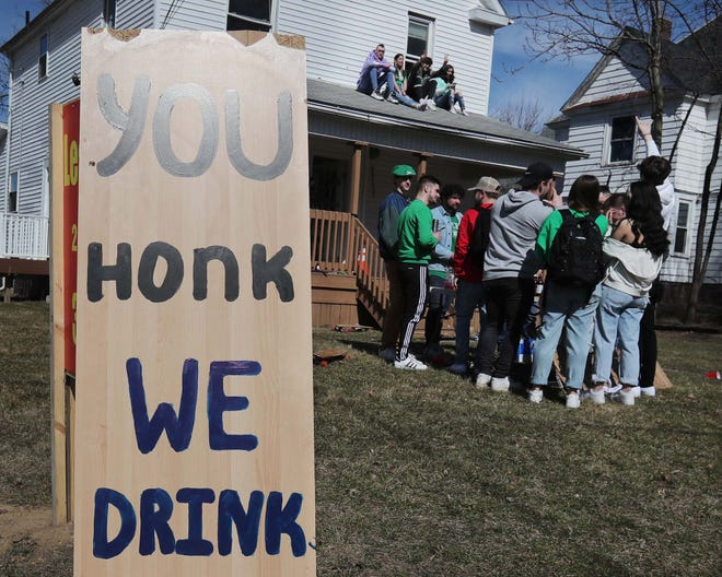 Revelers celebrate Fake Paddy's Day at an off campus house party in Kent. Nineteen citations were given out by the Kent Health Department. Those cited face a $500 fine and a visit to Kent State's Office of Student Conduct.