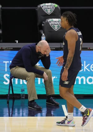 University of Akron coach John Groce reacts after Greg Tribble fouls out with seconds remaining in a 81-74 overtime loss to Buffalo in a Mid-American Conference semifinal game Friday night at Rocket Mortgage Fieldhouse. [Phil Masturzo/Beacon Journal]
