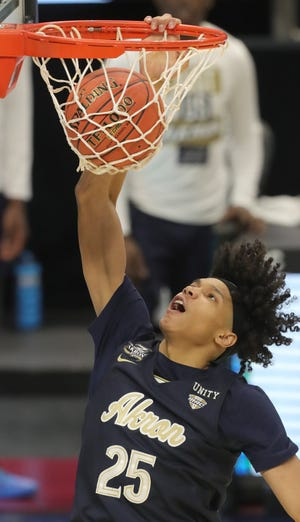 University of Akron forward Enrique Freeman throws down a dunk in the second half of the Zips' 81-74 overtime loss to Buffalo in a Mid-American Conference Tournament semifinal Friday at Rocket Mortgage FieldHouse in Cleveland. [Phil Masturzo/Beacon Journal]
