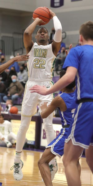 St. Vincent-St. Mary's Malaki Branham puts up a first quarter shot against Gilmore in the Division II Regional Championship game on Saturday, March 13, 2021 in Barberton, Ohio, at Barberton High school. The Irish won the game 67-40.  [Phil Masturzo/ Beacon Journal]
