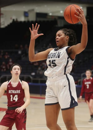 Archbishop Hoban's Lanae Riley grabs a rebound against Newark during the Div. I state semifinal girls basketball at the University of Dayton Arena on Friday March 12, 2021 in Dayton, Ohio. Hoban lost to Newark 55 to 41.