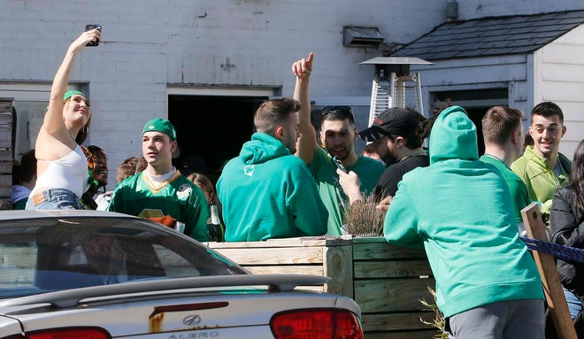 Bar patrons celebrate Fake Paddy's Day Saturday in Kent.
