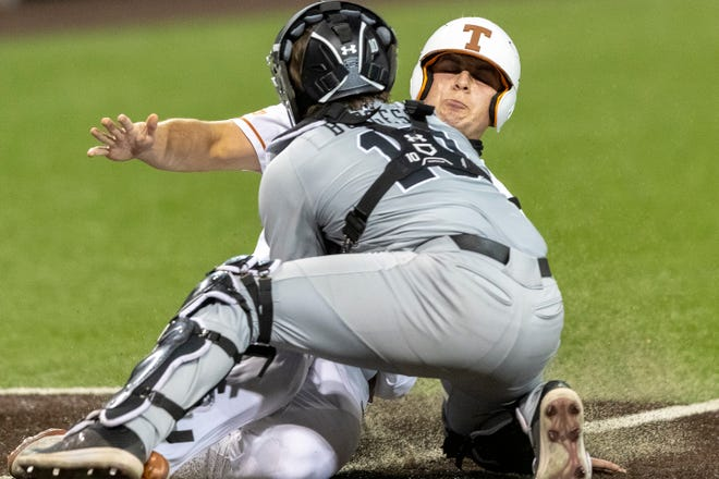 South Carolina catcher Colin Burgess tags out Texas' Ivan Melendez during a baseball game in Austin on March 12, 2021. No. 19 Texas later handed the 12th-ranked Gamecocks their first loss of the season.