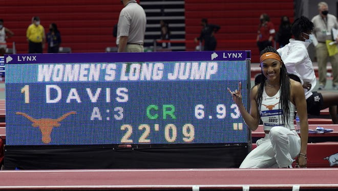Texas junior Tara Davis set a collegiate record in the indoor long jump in Fayetteville, Ark., on March 12, 2021.