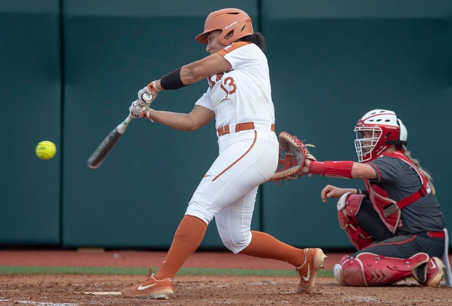 Texas infielder Shannon Rhodes (13) swings at a pitch against Houston during an NCAA softball tournament in 2019. Rhodes made history by tying a team record as she hit three home runs in a single game against UTSA at the Bevo Classic.