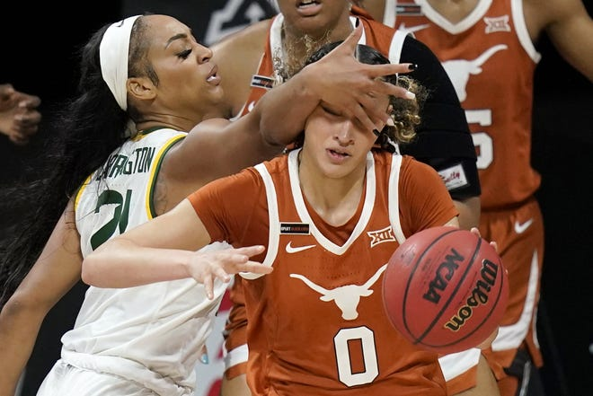 Texas guard Celeste Taylor is fouled by Baylor's DiJonai Carrington during the Longhorns' 66-55 loss in a Big 12 Tournament semifinal Saturday in Kansas City, Mo.