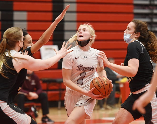 Beaver's Emma Pavelek drives to the hoop surrounded by Quaker Valley defenders during last Friday's WPIAL Class 4A championship at Peters Township High School.