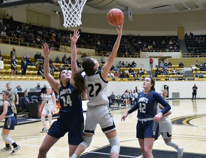 Andover Central's Brittany Harshaw (22) goes in for a reverse layup against St. Thomas Aquinas's Charlotte O'Keefe (24) in the second half of the Class 5A state championship game in Emporia, Kansas.